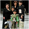 A Japanese family, wearing formal kimono, gathers for a picture