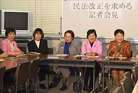 Women in business attire take part in a meeting
