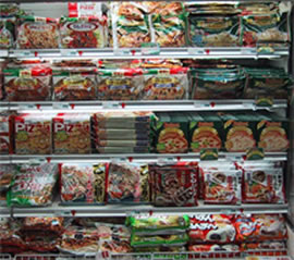 Japanese grocery store frozen foods section well-stocked with pizzas and more.