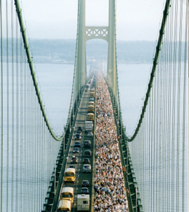View of bridge with people walking and traffic