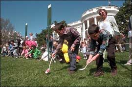 Children, at the White House, roll eggs with spoon