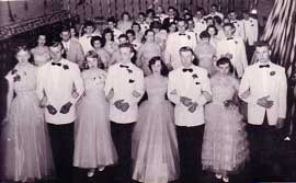 Rows of boys and girls dressed formally from 1950s