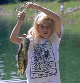 A young girl holds a line with three fish.