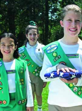 girl scouts with flag