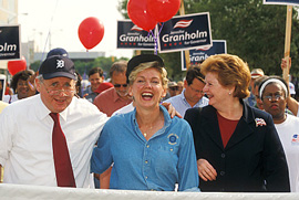 Three politicans walking in a parade