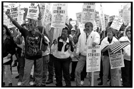 Striking workers chant during a protest.