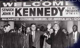 JFK stands beneath an AFL-CIO banner welcoming him