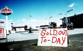 "Sign in front of a gas station, saying ""sold out"""