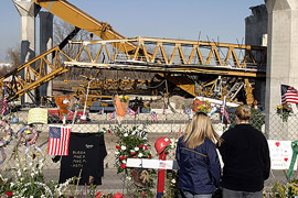 A memorial of flowers where a crane collapsed